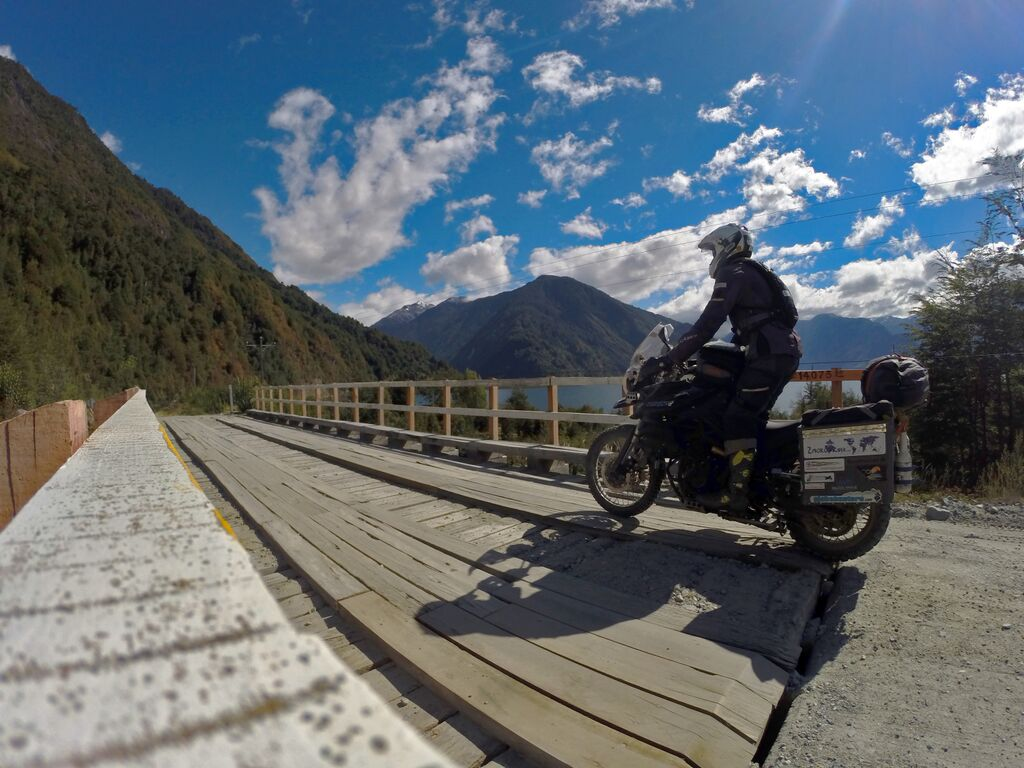 Rhys Lawrey riding across a bridge in Chile